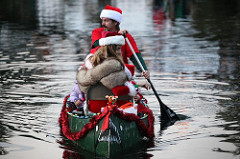 Father and Mother Christmas in a Canoe
